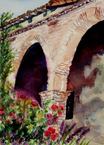 Painted during the San Juan Capistrano Mission tour this watercolor features stone arches and red flowers by Mary Benke