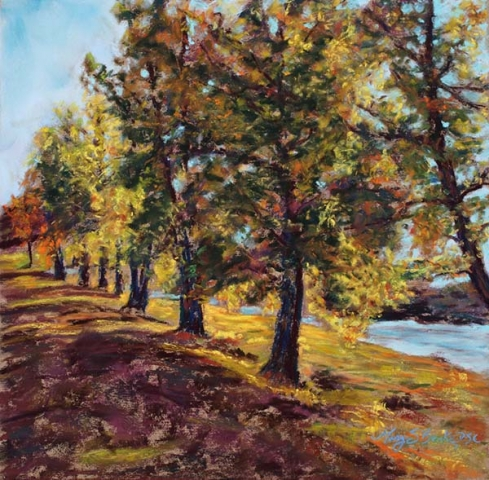 Pastel landscape painting of a row of colorful autumn trees with a river running in the background by Mary Benke