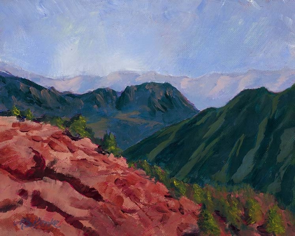 Landscape oil painting of a red ridge leading into green foothills with lavender mountains in the distance by Mary Benke