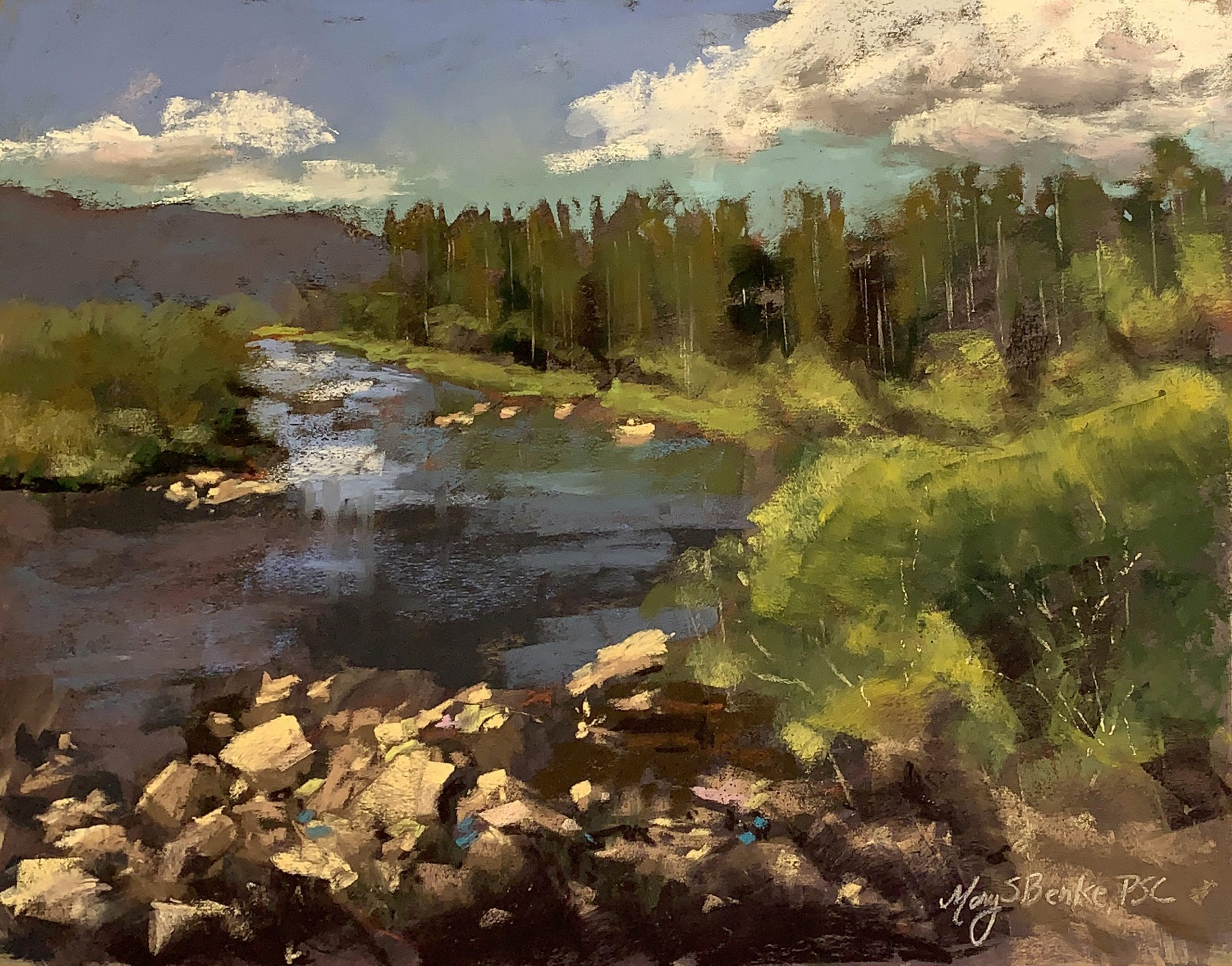 This pastel painting of a river leading toward Shadow Mountain near Grand Lake features a typical spectacular Colorado scene: colorful rocks, lush foliage, distant aspen trees, blue water, a purple mountain and dramatic sky by Mary Benke