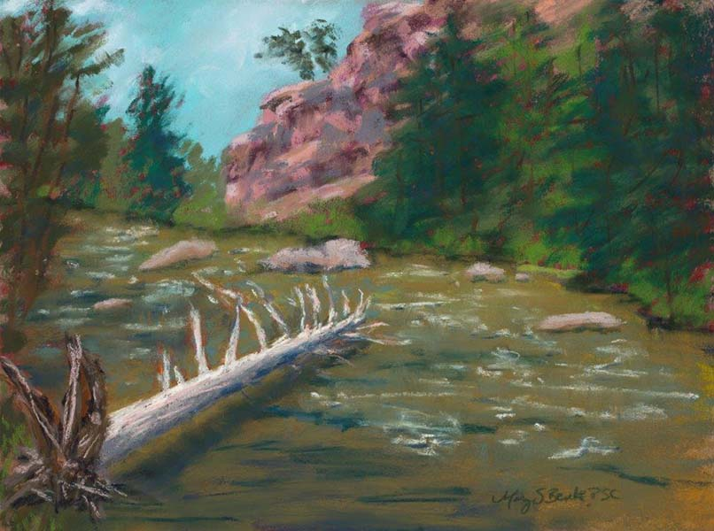 A pastel landscape painting featuring an old, fallen log in a fly fishing river surrounded by trees and dramatic rocks  by Mary Benke