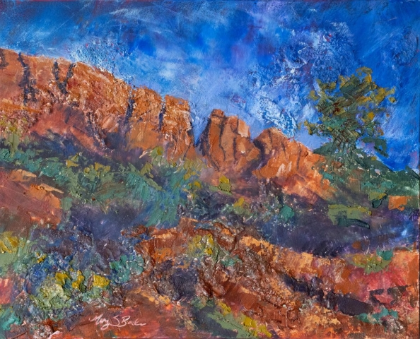 Highly textural oil paint makes the red rocks of iconic Horsetooth Mountain in Northern Colorado stand out against an brilliant blue evening sky. Painting by Mary Benke