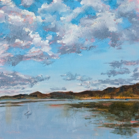 This glorious sunrise over Carter Lake in the summer is painted in oil. Dramatic clouds hover over a calm lake where a lone sailboat is moored. Painting by Mary Benke