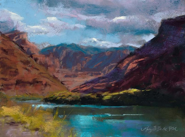 Pastel landscape painting Along the Colorado River featuring water, rocks, mountains, and Fisher Towers in Utah near Moab by Mary Benke
