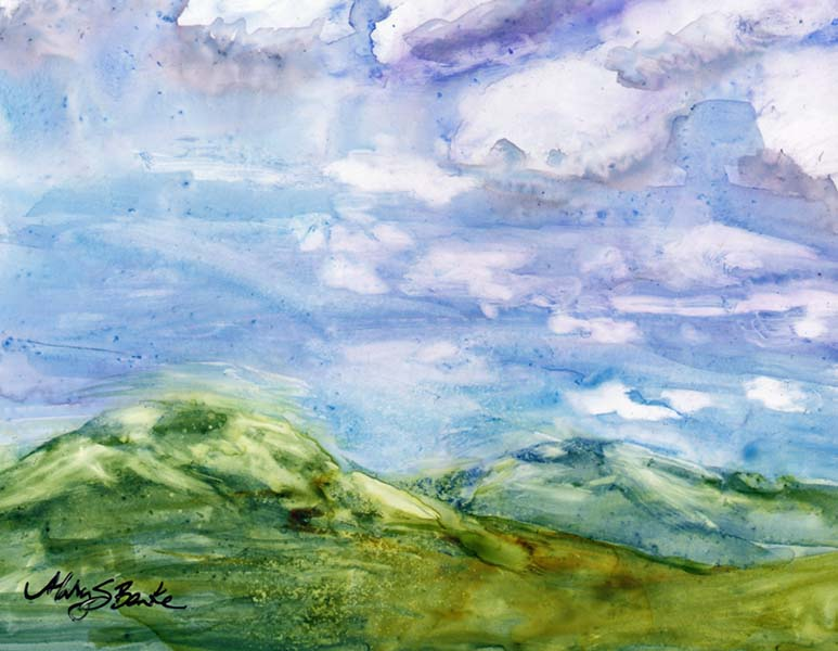Watercolor on Yupo painting of the top of mountains on Trail Ridge Road with a dramatic sky and clouds by Mary Benke