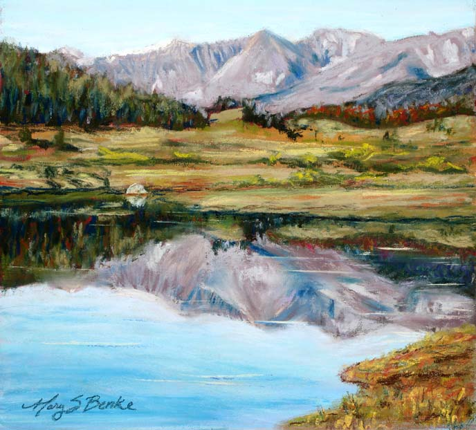 Pastel landscape of the mountains at Long Draw Reservoir reflected perfectly in the water by Mary Benke