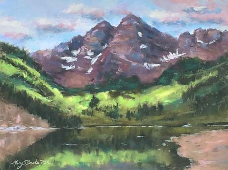 The iconic Maroon Bells near Aspen, Colorado, are reflected in a clear mountain lake in this peaceful pastel painting in lavenders, greens, and maroons by Mary Benke