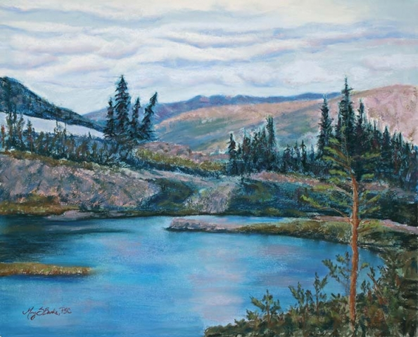 Pastel landscape painting of a high mountain lake with pine trees done in blues, pinks, and greens by Mary Benke