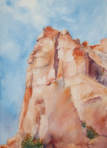 Landscape watercolor painting of a rock formation in Arches National Park, Utah, against a watercolor blue sky by Mary Benke