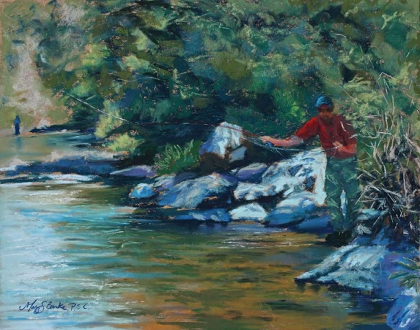 Pastel painting of a fly fisherman casting from a hiding place in the rocks along the shore in a picturesque river by Mary Benke