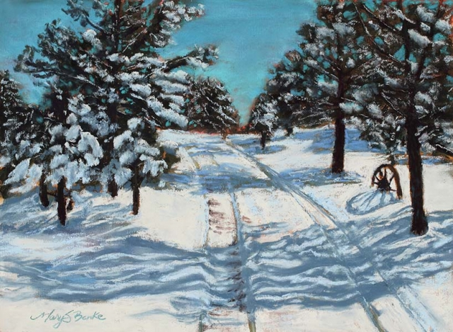 Lights and shadows make interesting patterns on the snow in this rustic winter scene with evergreen trees and a wagon wheel by Mary Benke