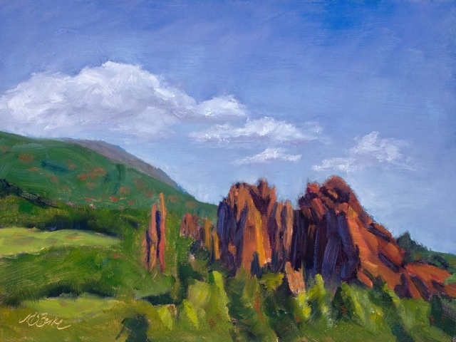 Landscape oil painting of the dramatic red rock formations in Colorado Springs' Garden of the Gods set against brilliant green foothills by Mary Benke