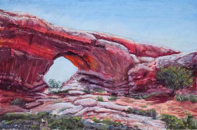 A vivid pastel landscape painting in oranges, reds, and rusts of the North Window rock formation in Arches National Park by Mary Benke