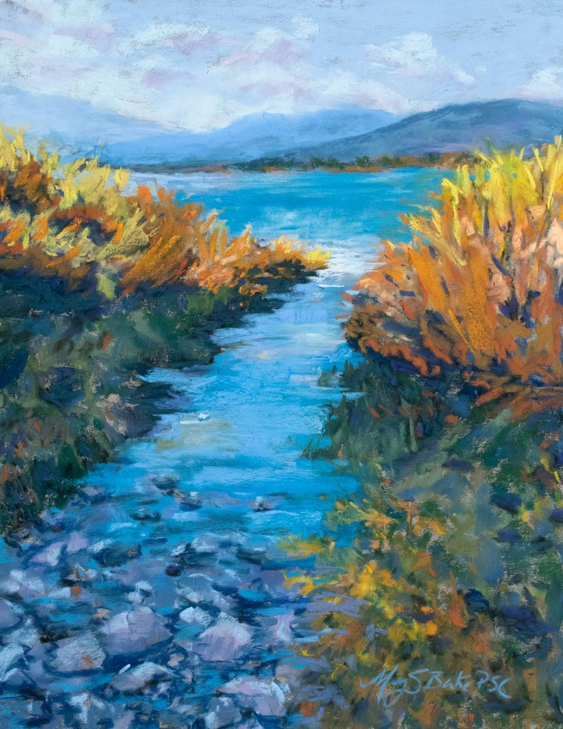 Pastel painting of a brilliant blue lake inlet surrounded by vibrant fall foliage with Tetons in the background by Mary Benke